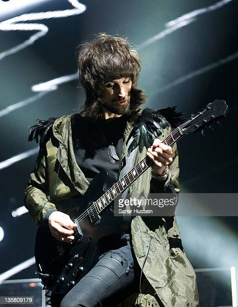 Sergio Pizzorno of Kasabian performs at the O2 Arena on December 14 2011 in London England
