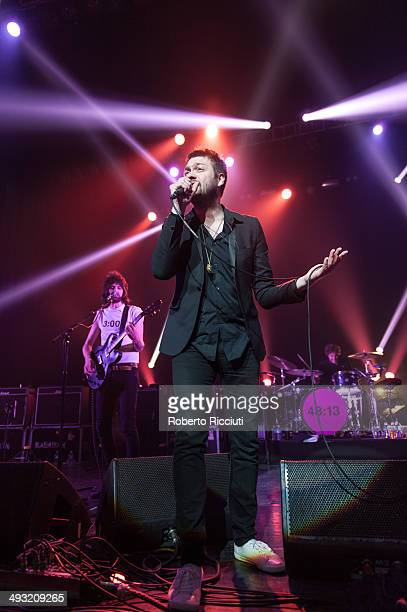 Sergio Pizzorno Tom Meighan and Ian Matthews of Kasabian perform on stage at Alhambra Theatre on May 22 2014 in Dunfermline United Kingdom