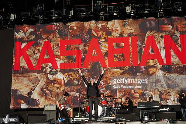 Sergio Pizzorno Tom Meighan and Ian Matthews of Kasabian performs on stage as support for Oasis at Heaton Park on June 4 2009 in Manchester England