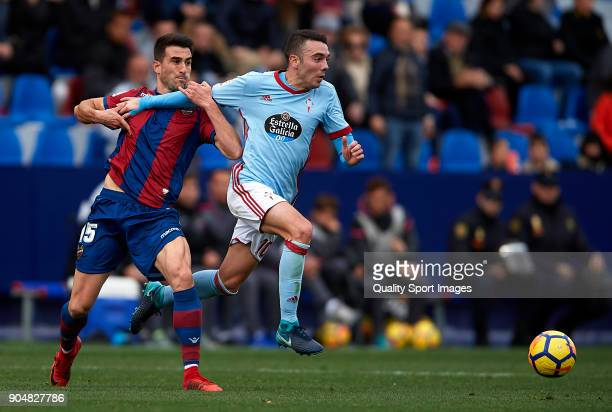 Sergio Postigo of Levante competes for the ball with Iago Aspas of Celta de Vigo during the La Liga match between Levante and Celta de Vigo at Ciutat...