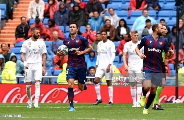 Sergio Postigo of Levante UD celebrates his team second goal during the La Liga match between Real Madrid CF and Levante UD at Estadio Santiago...