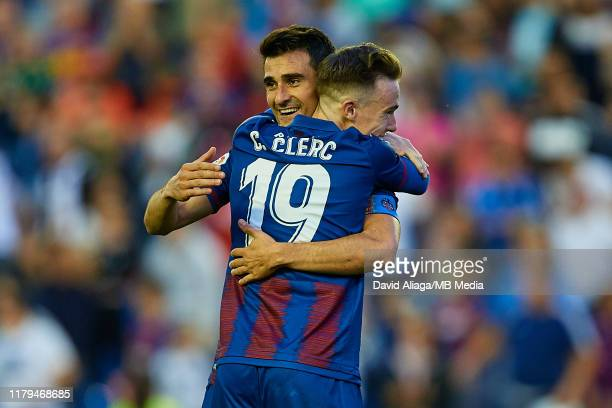Sergio Postigo of Levante UD celebrates the victory with his teammate Carlos Clerc during the Liga match between Levante UD and FC Barcelona at...