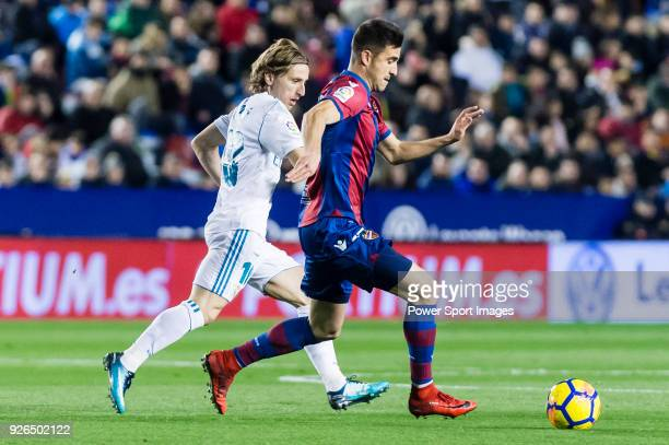 Sergio Postigo Redondo of Levante UD fights for the ball with Luka Modric of Real Madrid during the La Liga 201718 match between Levante UD and Real...