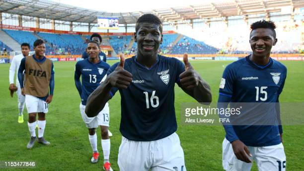 Sergio Quintero and Jesus Castillo of Ecuador smile as they leave the pitch following victory in the 2019 FIFA U20 World Cup Round of 16 match...
