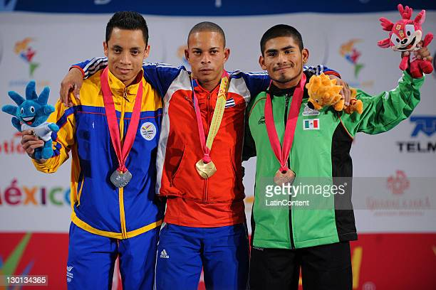Sergio Rada of Colombia winner of the silver medal Sergio Alvarez of Cuba winner of the gold medal and Jose Lino Montes of Mexico winner of the...