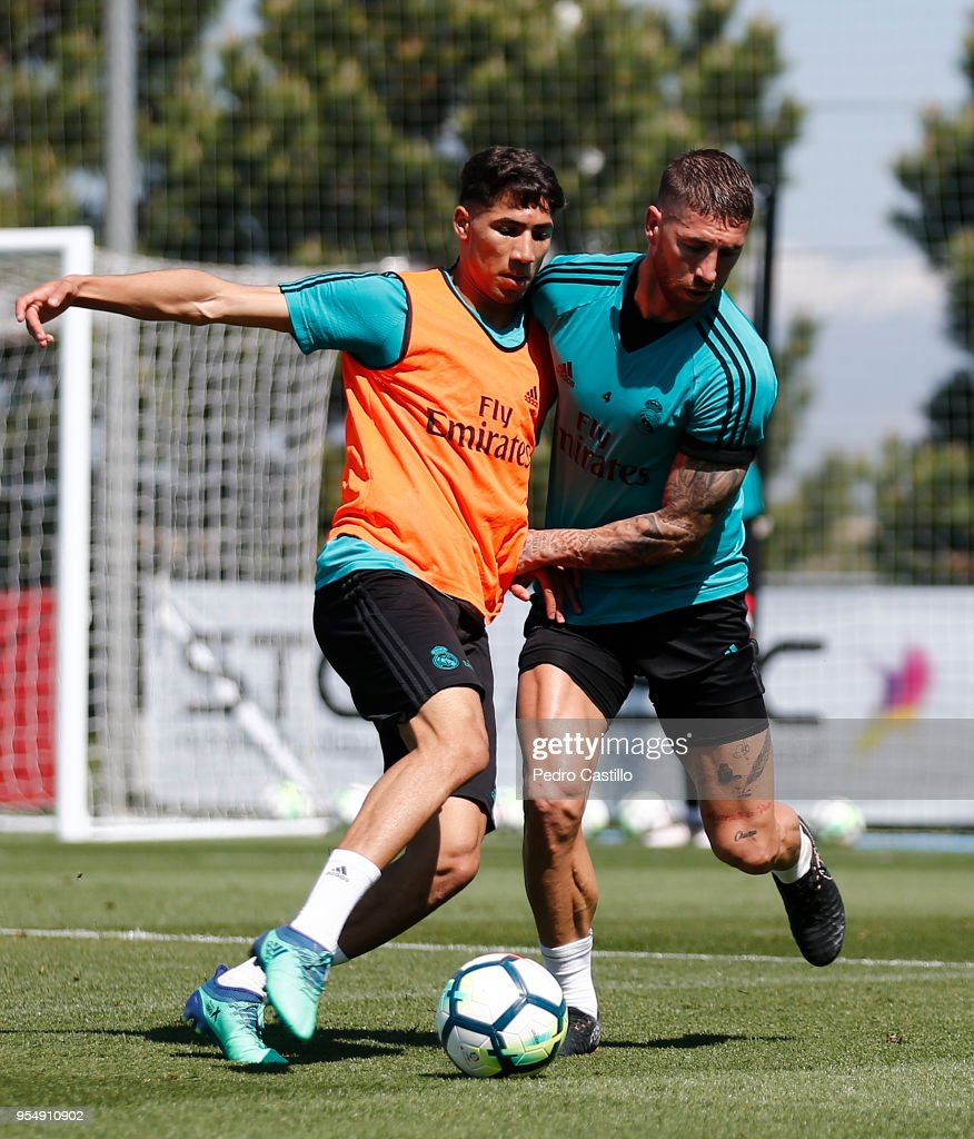 Sergio Ramos (R) and Achraf Hakimi of Real Madrid in action during a training session at Valdebebas training ground on May 5, 2018 in Madrid, .