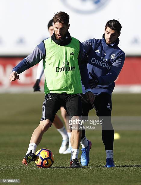 Sergio Ramos and Alvaro Morata of Real Madrid warm up during a training session at Valdebebas training ground on January 28 2017 in Madrid Spain