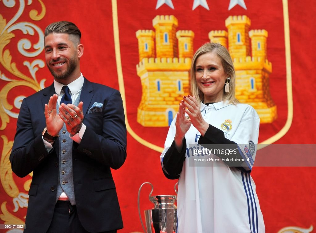 Sergio Ramos and Cristina Cifuentes celebrate during the Real Madrid celebration the day after winning the 12th UEFA Champions League Final at Casa de Correos on June 4, 2017 in Madrid, Spain.