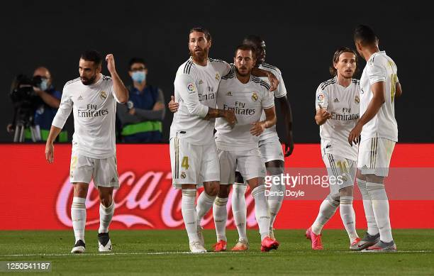 Sergio Ramos and Eden Hazard of Real Madrid CF celebrate the opening goal of team mate Karim Benzema during the Liga match between Real Madrid CF and...