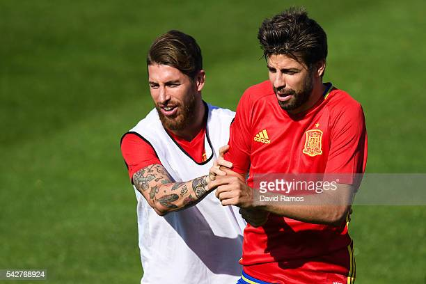 Sergio Ramos and Gerard Pique of Spain share a joke during a training session at Complexe Sportif Marcel Gaillard on June 24, 2016 in La Rochelle,...