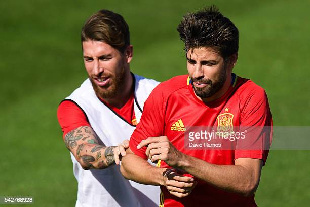 Sergio Ramos and Gerard Pique of Spain share a joke during a training session at Complexe Sportif Marcel Gaillard on June 24 2016 in La Rochelle...