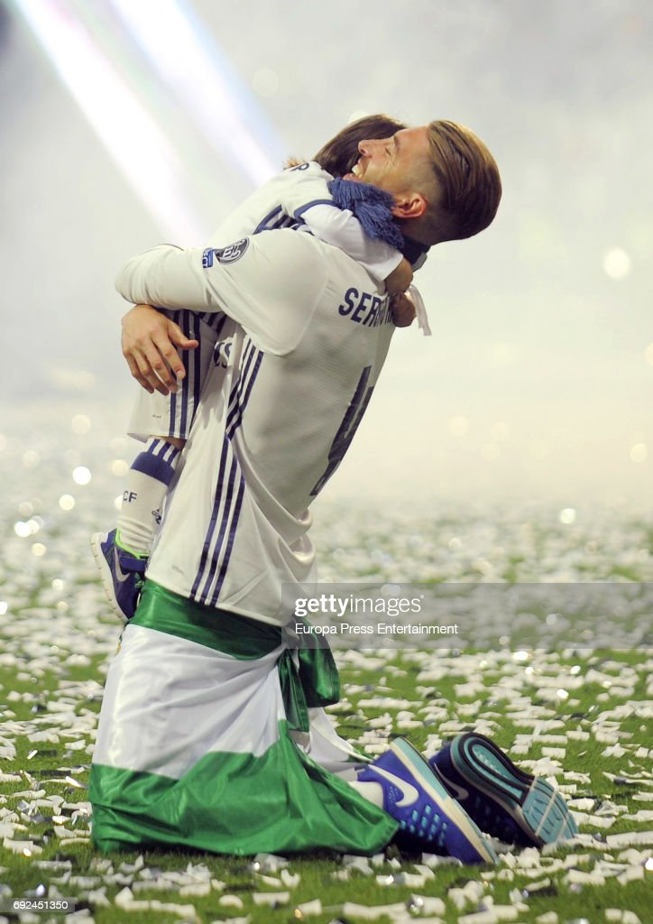 Sergio Ramos and his son Sergio Ramos Rubio celebrate during the Real Madrid celebration the day after winning the 12th UEFA Champions League Final at Santiago Bernabeu stadium on June 4, 2017 in Madrid, Spain.