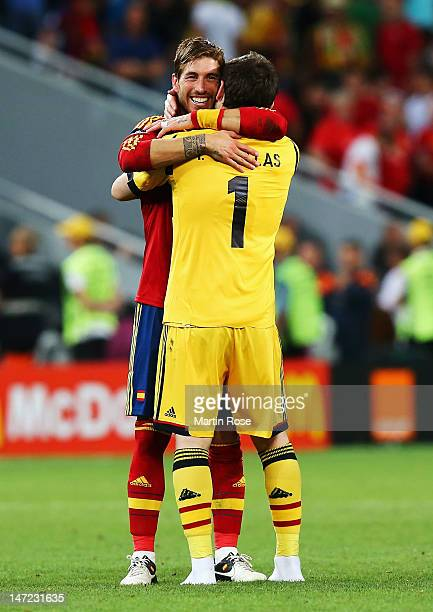 Sergio Ramos and Iker Casillas of Spain celebrate victory during the UEFA EURO 2012 semi final match between Portugal and Spain at Donbass Arena on...