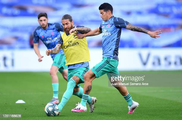 Sergio Ramos and James Rodríguez of Real Madrid warm up ahead of the Liga match between Real Sociedad and Real Madrid CF at Estadio Anoeta on June 21...