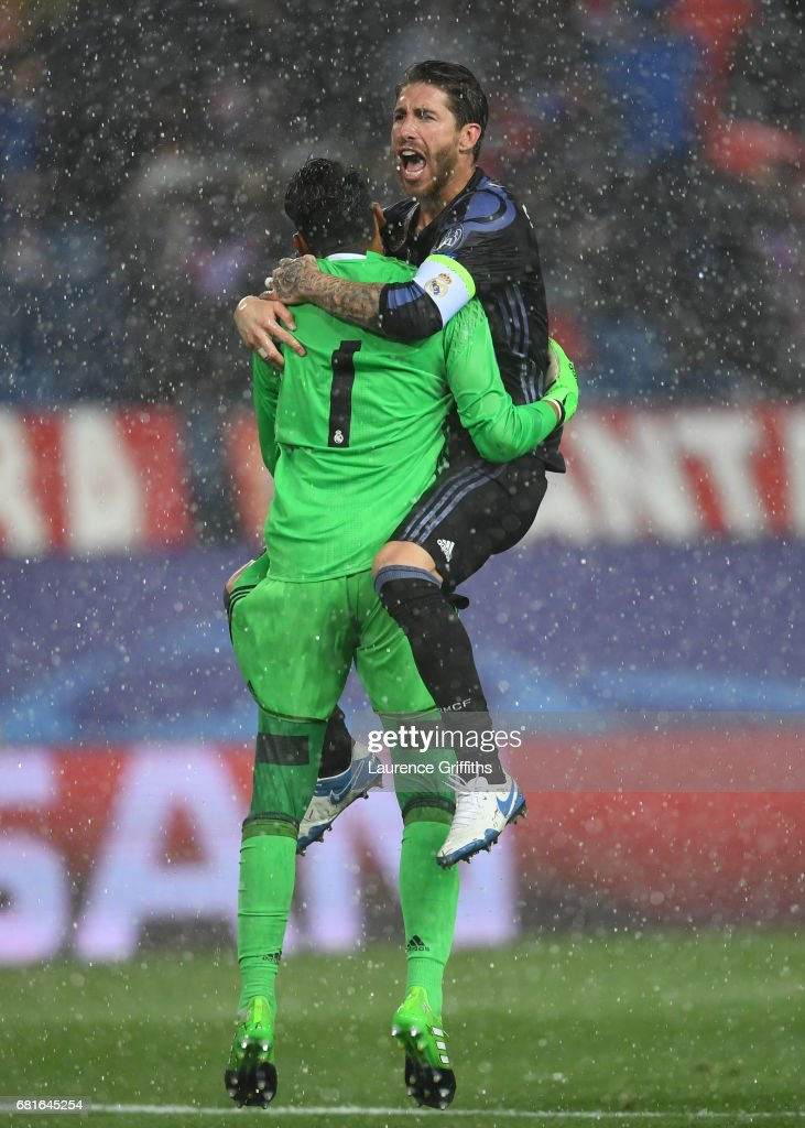 Sergio Ramos and Keylor Navas of Real Madrid celebrate at the end of the UEFA Champions League Semi Final second leg match between Club Atletico de Madrid and Real Madrid CF at Vicente Calderon Stadium on May 10, 2017 in Madrid, Spain.