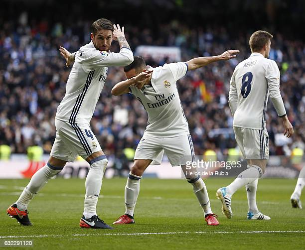 Sergio Ramos and Lucas Vazquez of Real Madrid celebrate after scoring during the La Liga match between Real Madrid and Malaga CF at Estadio Santiago...