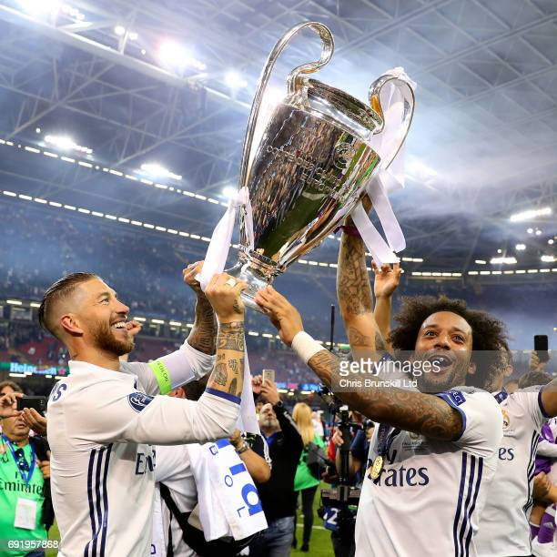 Sergio Ramos and Marcelo of Real Madrid celebrate with the trophy following the UEFA Champions League Final match between Juventus and Real Madrid at...