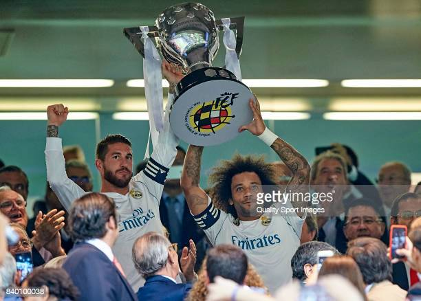 Sergio Ramos and Marcelo of Real Madrid celebrates with the La Liga trophy prior to the the La Liga match between Real Madrid and Valencia at Estadio...