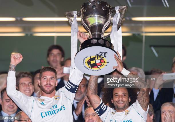 Sergio Ramos and Marcelo Vieira Da Silva of Real Madrid hold up one of their trophies prior to the La Liga 201718 match between Real Madrid and...