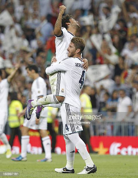 Sergio Ramos and Marcelo Vieira of Real Madrid celebrate after winning the Supercopa second leg match between Real Madrid and FC Barcelona at Estadio...