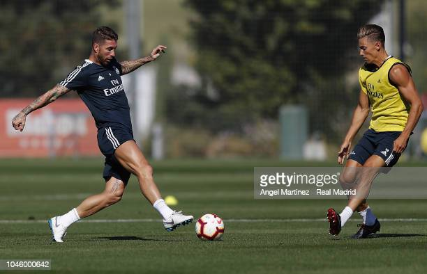 Sergio Ramos and Marcos Llorente of Real Madrid in action during a training session at Valdebebas training ground on October 5 2018 in Madrid Spain