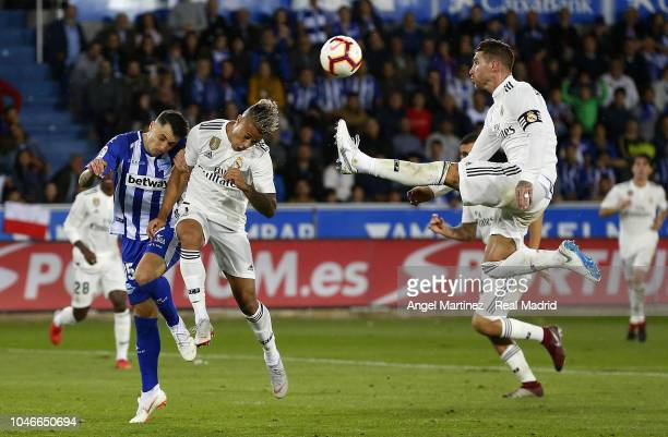 Sergio Ramos and Mariano Diaz of Real Madrid compete for the ball with Ximo Navarro of Deportivo Alaves during the La Liga match between Deportivo...