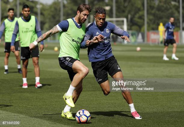 Sergio Ramos and Mariano Diaz of Real Madrid in action during a training session at Valdebebas training ground on April 22 2017 in Madrid Spain