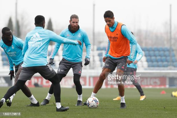 Sergio Ramos and Raphaël Varane of Real Madrid in action during a training session at Valdebebas training ground on February 03, 2021 in Madrid,...