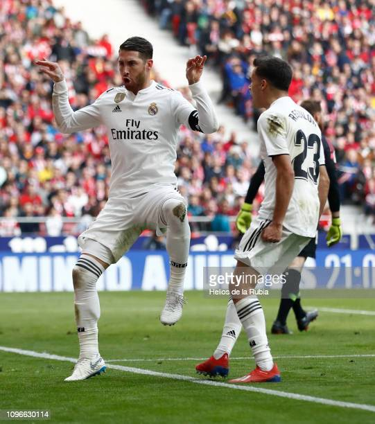 Sergio Ramos and Sergio Reguilon of Real Madrid celebrate after the opening goal during the La Liga match between Club Atletico de Madrid and Real...
