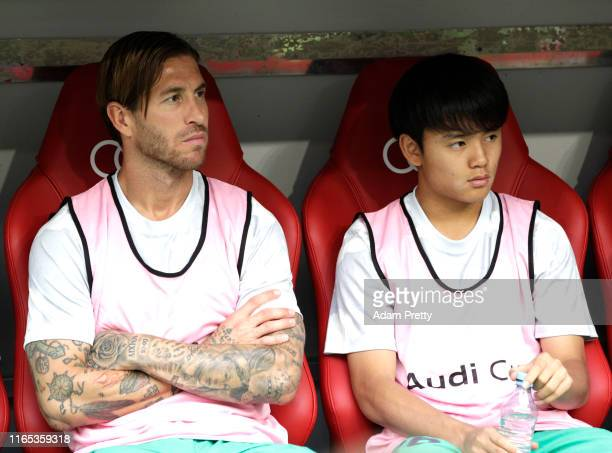 Sergio Ramos and Takefusa Kubo of Real Madrid sit on the bench during the Audi cup 2019 3rd place match between Real Madrid and Fenerbahce at Allianz...