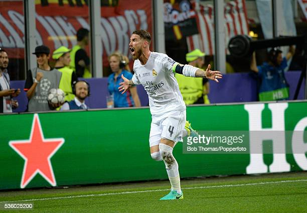 Sergio Ramos celebrates after scoring Real Madrid's opening goal during the UEFA Champions League Final match between Real Madrid and Club Atletico...