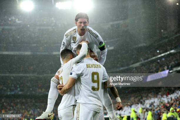 Sergio Ramos celebrates with Karim Benzema of Real Madrid after scoring his team's first goal during the UEFA Champions League group A match between...