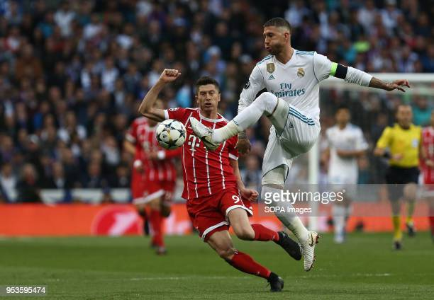 Sergio Ramos competes for the ball with Robert Lewandowski during the UEFA Champions League Semi Final Second Leg match between Real Madrid and...