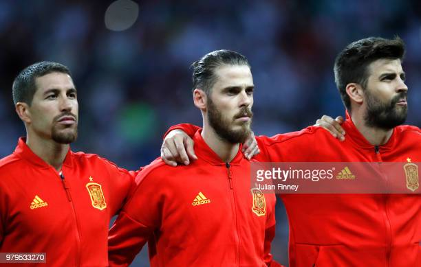 Sergio Ramos, David De Gea and Gerard Pique of Spain look on during the national anthem prior to the 2018 FIFA World Cup Russia group B match between...
