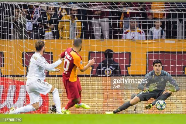Sergio Ramos Garcia of Real Madrid CF Younes Belhanda of Galatasaray AS goalkeeper Thibaut Courtois of Real Madrid CF during the UEFA Champions...