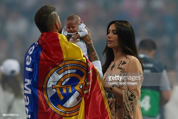 Sergio Ramos holds his new born Marco Ramos with wife Pilar Rubio during Real Madrid team celebration at Santiago Bernabeu Stadium after winning the...