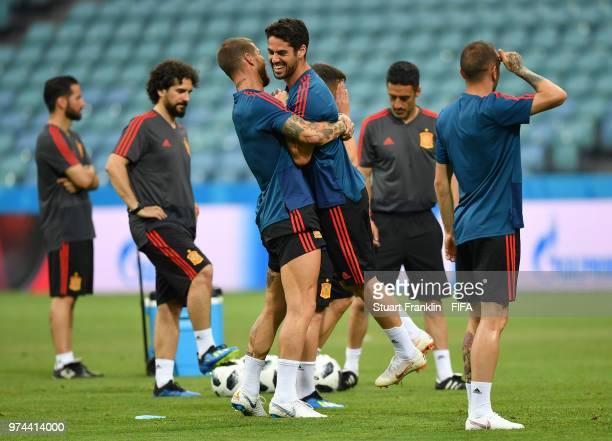 Sergio Ramos hugs Isco of Spain during training of the Spanish national football team at Fisht Stadium on June 14 2018 in Sochi Russia