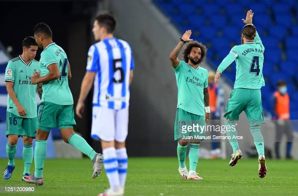 Sergio Ramos is congratulated by team mate Marcelo after scoring the first goal from the penalty spot during the Liga match between Real Sociedad and...