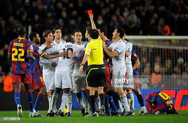 Sergio Ramos is shown the red card by referee Iturralde Gonzalez during the La Liga match between Barcelona and Real Madrid at the Camp Nou Stadium...