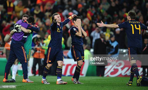 Sergio Ramos Jesus Navas and Xabi Alonso of Spain celebrate victory at the final whistle during the 2010 FIFA World Cup South Africa Final match...