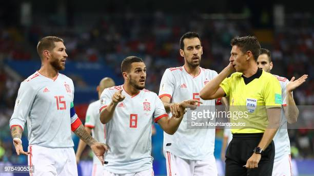 Sergio Ramos Koke and Sergio Busquets of Spain confront referee Gianluca Rocchi after he awards Portugal a penalty during the 2018 FIFA World Cup...