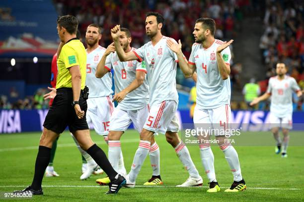Sergio Ramos Koke Sergio Busquets and Nacho of Spain complain to Referee Gianluca Rocchi after he awards Portugal a penalty during the 2018 FIFA...