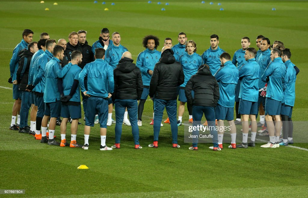 Sergio Ramos, Marcelo, Luka Modric, Marco Asensio, Mateo Kovacic, Keylor Navas of Real Madrid and teammates listen to coach of Real Madrid Zinedine Zidane during Real Madrid's training on the eve of UEFA Champions League match between Paris Saint Germain (PSG) and Real Madrid at Parc des Princes stadium on March 5, 2018 in Paris, .