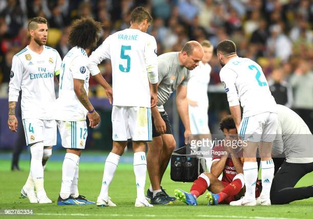 Sergio Ramos Marcelo Raphael Varane and Daniel Carvajal of Real Madrid check if Mohamed Salah of Liverpool is ok when he goes down injured during the...