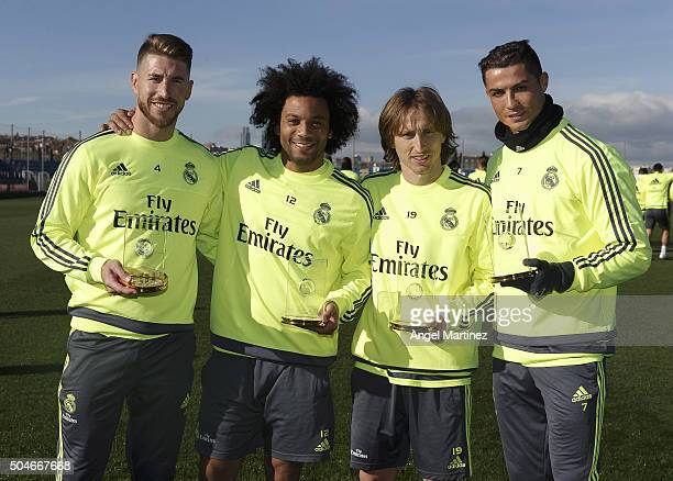 Sergio Ramos Marcelo Vieira Luka Modrid and Cristiano Ronaldo of Real Madrid pose with their FIFA FIFPro World XI for 2015 trophies during a training...