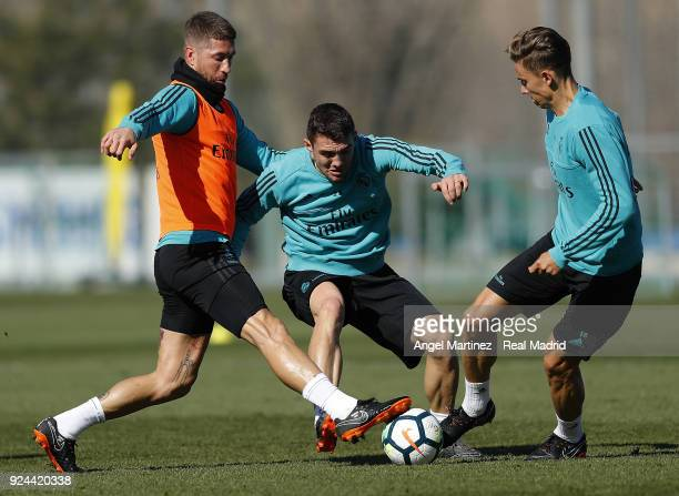 Sergio Ramos Mateo Kovacic and Marcos Llorente of Real Madrid in action during a training session at Valdebebas training ground on February 26 2018...