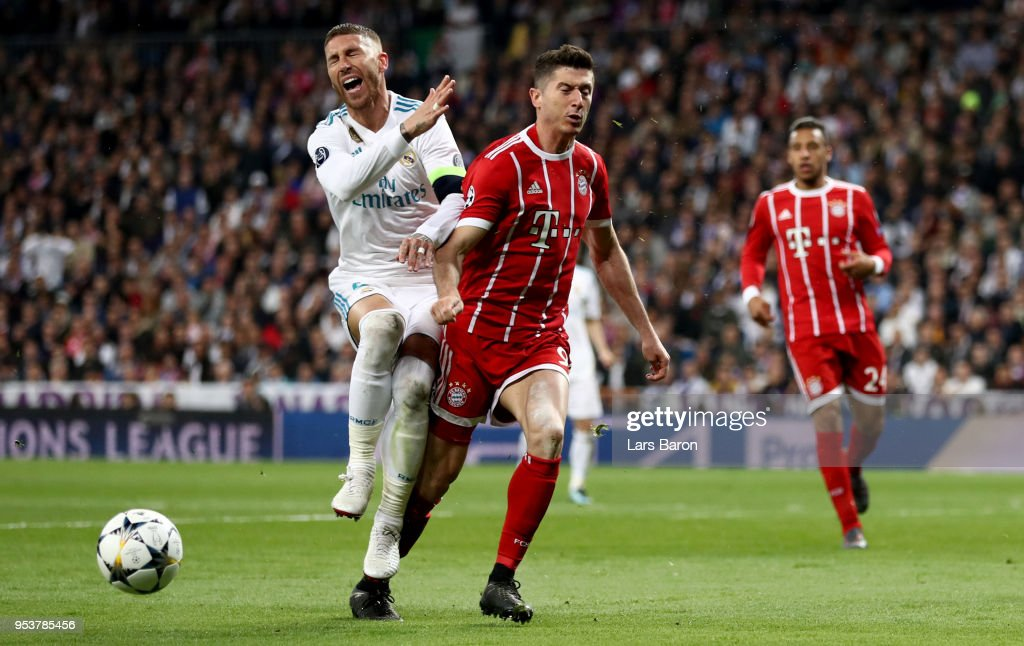 Sergio Ramos of Madrid challenges Robert Lewandowski of Bayern Muenchen during the UEFA Champions League Semi Final Second Leg match between Real Madrid and Bayern Muenchen at the Bernabeu on May 1, 2018 in Madrid, Spain.