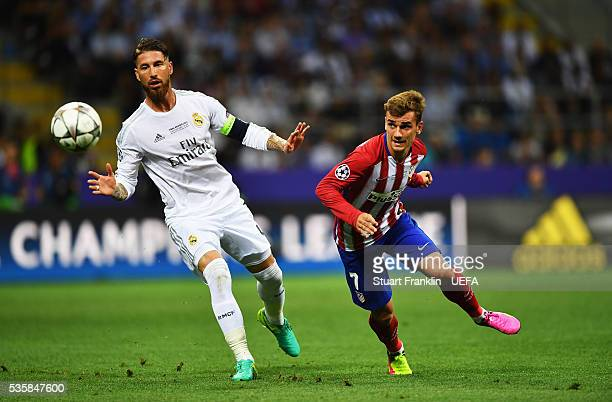 Sergio Ramos of Madrid is challenged by of Antoine Griezmann Athletico during the UEFA Champions League Final match between Real Madrid and Club...