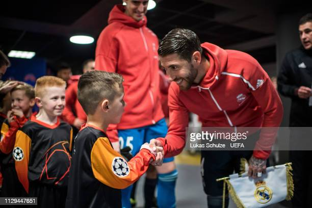 Sergio Ramos of Madrid talks to a escort kids in the players tunnel prior to the UEFA Champions League Round of 16 First Leg match between Ajax and...