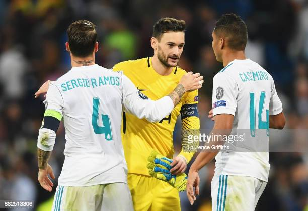 Sergio Ramos of Real Madrid and Casemiro of Real Madrid shake hands with Hugo Lloris of Tottenham Hotspur during the UEFA Champions League group H...